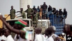 Southern Sudanese security forces watch over an independence rehearsal procession in Juba, South Sudan, July 7, 2011