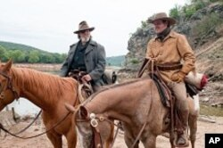 "Left to right: Jeff Bridges plays Rooster Cogburn and Matt Damon plays LaBeouf in Paramount Pictures' ""True Grit."""