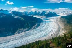 This September 2017 photo provided by researcher Brian Menounos shows the Klinaklini glacier in British Columbia, Canada. (Brian Menounos via AP)