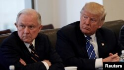 FILE - Donald Trump sits with U.S. Senator Jeff Sessions, R-Ala., at Trump Tower in Manhattan, New York, Oct. 7, 2016.