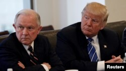 FILE - Donald Trump sits with U.S. Senator Jeff Sessions at Trump Tower in Manhattan, New York, Oct. 7, 2016.