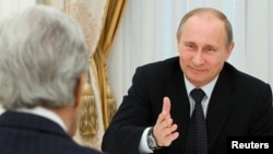 FILE - Russian President Vladimir Putin, right, speaks with U.S. Secretary of State John Kerry in the Kremlin in Moscow, May 7, 2013.