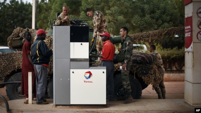 French soldiers fill up their tank at a local petrol station in Sevare, some 620 kilometers (385 miles) north of Mali's capital Bamako,  Jan. 25, 2013.