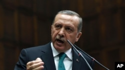 Turkey's Prime Minister Recep Tayyip Erdogan addresses his supporters at the parliament in Ankara, Turkey, Jan. 14, 2014.