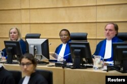 FILE - Judges Sanji Mmasenono Monageng (C) , Sylvia Steiner (L) and Cuno Tarfusser (R) of the International Criminal Court (ICC) attend a meeting about Libya in The Hague, June 27, 2011.