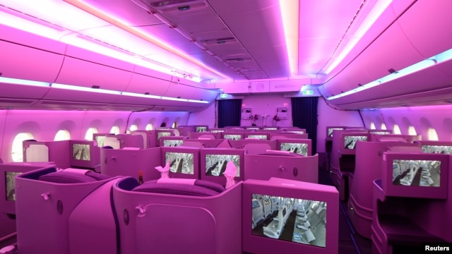 The new cabin of an Airbus A350 XWB flight-test aircraft is illuminated during a media-day at the German headquarters of aircraft company Airbus in Hamburg-Finkenwerder, April 7, 2014.