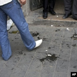 Eggs used by supporters of Syrian President Bashar Assad to pelt the US Ambassador, Robert Ford when he entered the office of an opposition member in Damascus litter the ground, September 29, 2011