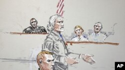 U.S. Army Staff Sgt. Calvin Gibbs, seated at lower left, is shown in this courtroom sketch as his attorney Phil Stackhouse stands at center, and military Judge Lt. Col. Kwasi Hawks listens, at top left, October 31, 2011, at Joint Base Lewis-McChord in Was