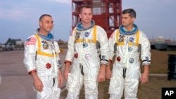 In this undated photo made available by NASA, (L-R), veteran astronaut Virgil Grissom, first American spacewalker Ed White and rookie Roger Chaffee, stand for a photograph in Cape Kennedy, Florida, today Cape Canaveral.
