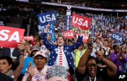 Delegates react during the final day of the Democratic National Convention in Philadelphia, July 28, 2016.
