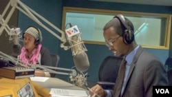 VOA Somali's Falastin A. Iman and Ismail H. Mohamed on air during the program's first broadcast on November 30