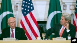 Secretary of State John Kerry and Pakistan Foreign Affairs Adviser Sartaj Aziz participate in the U.S.-Pakistan Strategic Dialogue meeting at the State Department in Washington, Feb. 29, 2016.