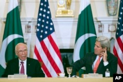 FILE - Secretary of State John Kerry and Pakistan Foreign Affairs Adviser Sartaj Aziz, participate in the U.S.-Pakistan Strategic Dialogue meeting at the State Department in Washington, Feb. 29, 2016.
