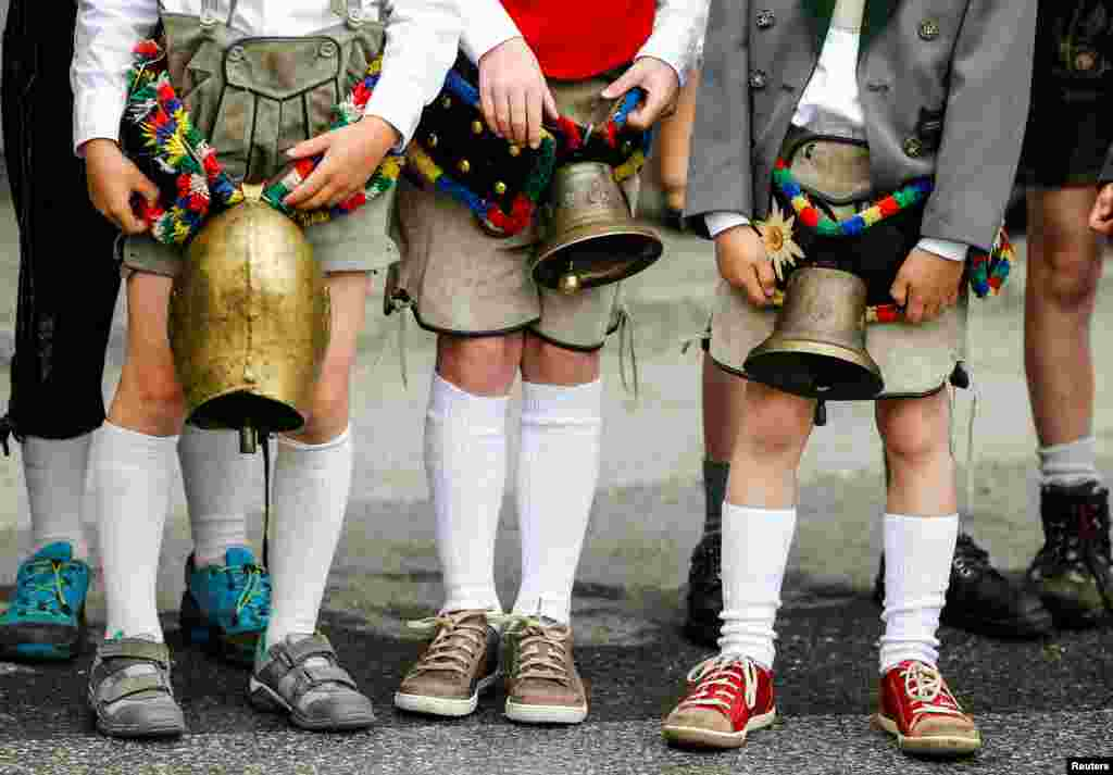 Children in traditional Tyrolean clothes attend a parade at the annual Gauner Festival in Zell am Ziller, Austria.