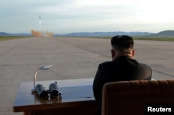 FILE - North Korean leader Kim Jong Un watches the launch of a Hwasong-12 missile in this undated photo released by North Korea's Korean Central News Agency, Sept. 16, 2017.