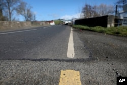 A view of the Irish border near the town of Middletown, Northern Ireland, March, 12, 2019. All that makes the border crossing visible is the change in paint on the road markings and the cut in the tarmac, with white paint being in Northern Ireland and yellow paint used in the Republic of Ireland.