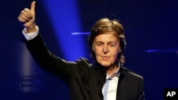 """Paul McCartney performs during the first U.S concert of his """"Out There!"""" world tour in Orlando, Fla., May 18, 2013."""