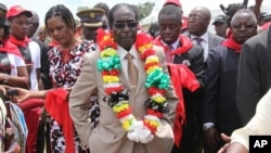 FILE: Zimbabwean President Robert Mugabe is seen during celebrations to mark his 89th birthday in Bindura about 100 kilometres north of Harare, Saturday, March, 2, 2013.