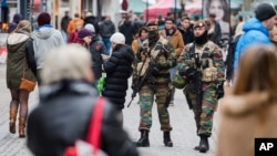 Soldiers from the Belgian army patrol in the picturesque Grand Place in Brussels, Nov. 20, 2015.