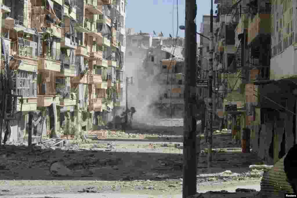 A view of a street filled with rubble and damaged buildings in Aleppo's Salaheddine neighborhood, April 28, 2013.