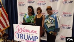 "Social media personalities Lynette Hardaway, left, and Rochelle Richardson, right, known collectively as ""Diamond and Silk,"" pose with actress Stacey Dash at the unveiling of the Women Vote Trump Super PAC in Washington, D.C., June 9, 2016. (W. Gallo/VOA)"