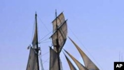 A replica of the Amistad sails past Manhattan in New York Harbor.