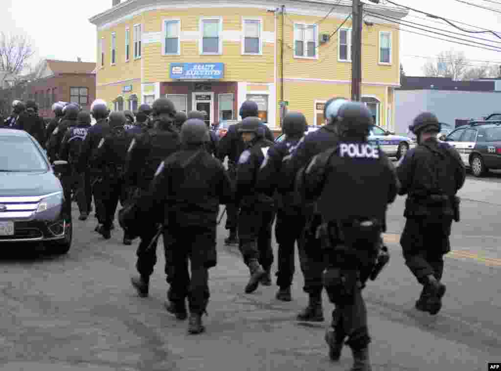 Police walk down School and Walnut Street on April 19, 2013 in Watertown, Massachusetts.