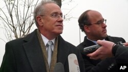 Robert Goldberg, the US embassy's deputy chief of mission, speaks to journalists outside the Beijing High People's Court