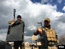 Two fighters of the Dwekh Nawsha Christina militia protecting traditional Christian lands from IS extremists. Although under equipped, the Kurdish Peshmerga are nearby and they are determined to stay. (S. Behn/VOA)