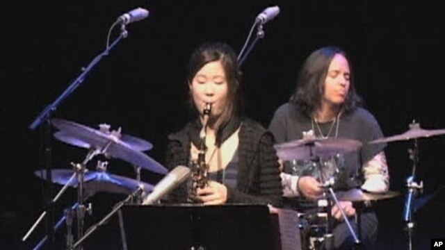 Jazz saxophone player Grace Kelly (center) on stage