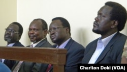 Former SPLM secretary-general Pagan Amum (second from left) testified in his own defense in a court in Juba on Friday, April 11.