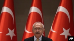FILE - Turkey's main opposition Republican People's Party leader Kemal Kilicdaroglu speaks during a meeting with journalists in Istanbul.
