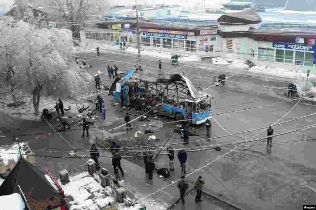 Investigators work at the site of a blast on a bus in Volgograd, Russia, Dec. 30, 2013.