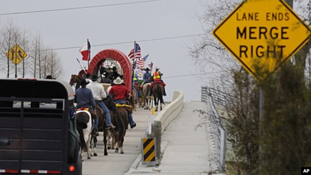 Members of the Valley Lodge Trail Ride make their way up a highway entrance ramp, in Houston to kick-off the Houston Livestock Show and Rodeo, (File February 24, 2011).