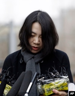 Cho Hyun-ah, Korean Air's former head of cabin service, arrives for questioning at the Ministry of Land, Infrastructure and Transport offices in Seoul, South Korea, Dec. 12, 2014.