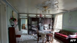 An interior view of a house which is said was damaged in recent shelling during clashes between Armenian separatists and Azerbaijan over the breakaway Nagorny Karabakh region, in the village of Sahlabad outside the Azerbaijani city of Tartar