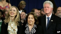 Former President Bill Clinton and his daughter, Chelsea, flank Dorothy Rodham, mother of then-Democratic presidential hopeful Sen. Hillary Rodham Clinton, D-N.Y., as she speaks at her Pennsylvania primary election night party, April 22, 2008. (file photo)