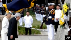 Japan's Emperor Akihito and Empress Michiko bow before the monument of Dr. Jose P. Rizal, the country's National Hero, during a wreath-laying ceremony Wednesday, Jan. 27, 2016 in Manila, Philippines.