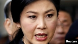 FILE - Thailand's Prime Minister Yingluck Shinawatra speaks to the media after a cabinet meeting at the Royal Thai Air Force Headquarters in Bangkok.