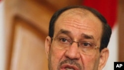 Iraqi Prime Minister Nuri al-Maliki holds a press conference in Baghdad as he called for a dialogue with rival blocs to gauge whether or not US troops currently in Iraq should stay beyond a year-end deadline for their withdrawal, May 11, 2011