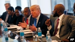 Republican presidential candidate Donald Trump holds a roundtable meeting with the Republican Leadership Initiative in his offices at Trump Tower in New York, Aug. 25, 2016. Dr. Ben Carson is seated next to Trump at center.
