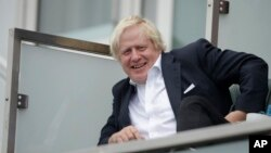 Britain's former Foreign Secretary Boris Johnson attends the fifth cricket test match of a five match series between England and India at the Oval cricket ground in London, Sept. 8, 2018.