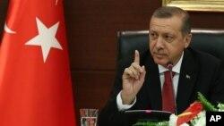 Turkish Prime Minister Tayyip Erdogan speaks to the media in his office in Ankara, Turkey, April 23, 2014.