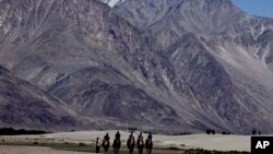 Tourists in Ladakh, India. The heavily militarized region also borders China, and is at the center of a long-running dispute between the two countries.