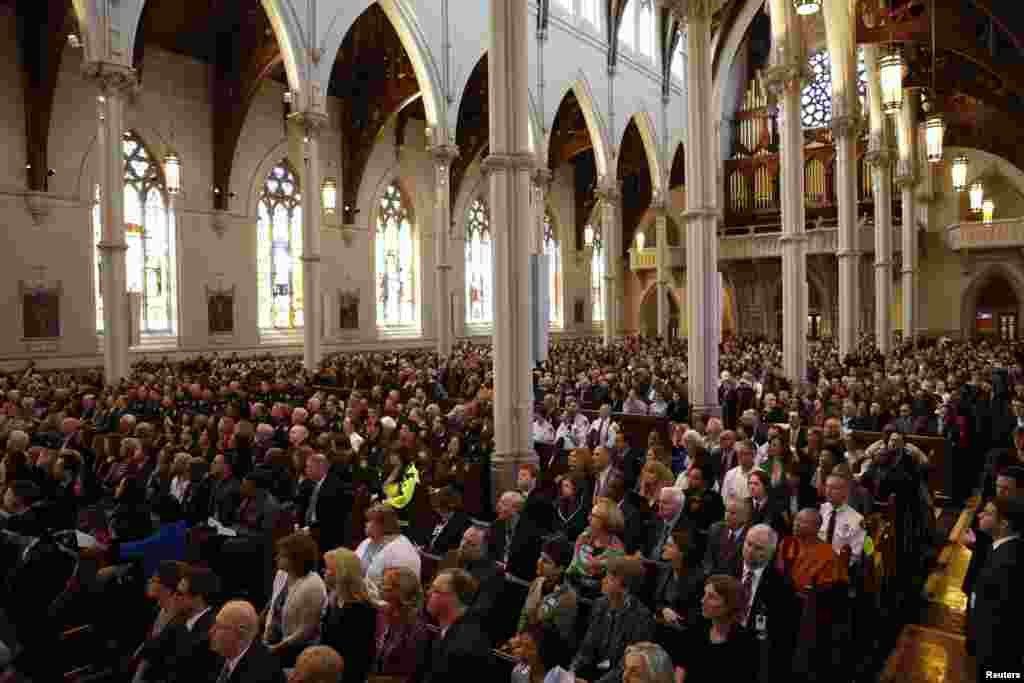 People attend the interfaith memorial service at the Cathedral of the Holy Cross for the victims of the Boston Marathon bombing in Boston, April 18, 2013.