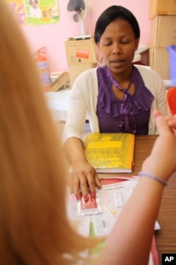 HIV/AIDS counselor Cecilia Makiwane advises patient Brenda Marais before Marais undergoes a test for HIV