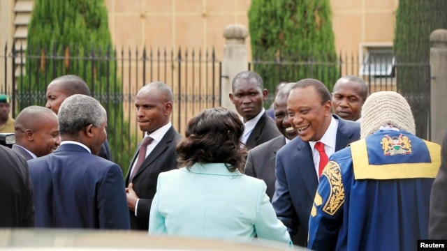 Kenyan President Uhuru Kenyatta (in red tie)  arrives at the Parliament Building to deliver his state of the nation address in Nairobi, March 27, 2014.
