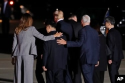 First lady Melania Trump and Vice President Mike Pence put their arms around North Korean detainee Tony Kim as they walk with President Donald Trump, Secretary of State Mike Pompeo, Kim Dong Chul, and Kim Hak Song as they leave Andrews Air Force Base, Md.
