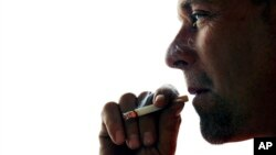 John Cormier smokes a cigarette on Main Street in Westminster, Mass., Thursday, Nov. 6, 2014.
