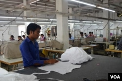 Wages of garment workers are higher than in some other industries. (A. Pasricha/VOA)